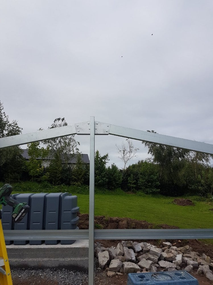 Begin attaching the roof beams to the haunch brackets