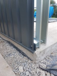 Affix drip rail and a metal sheet side wall to one of the side frames