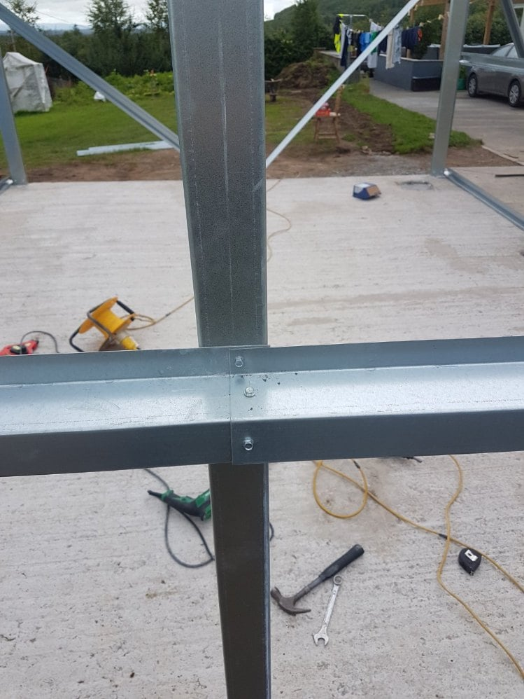 Screw the purlins to the gable post
